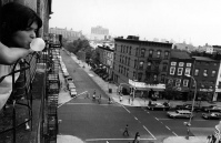 Jeanette Alejandro Looking Out Her Window in Brooklyn, 1978